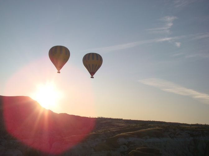 Meeting the rising sun over the valleys and vineyards of Cappadocia