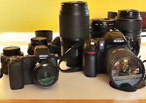 Left   Nikon 1 V2 Mirrorless camera Nikkor 18.5mm F1.8 fixed lens (equal to 50mm in 35mm format) Nikkor VR 30-110mm f/3.8-5.6 lens (equal to 81-297mm in 35mm format) Nikkor VR 10-30mm f/3.5-5.6 lens (equal to 27-81mm in 35mm format) Left Nikon D80  Nikkor 18-200mm VR  Nikkor 70-300mm VR  Nikkor 105mm Fixed VR  Nikkor 24-85 mm F/2.8 VR