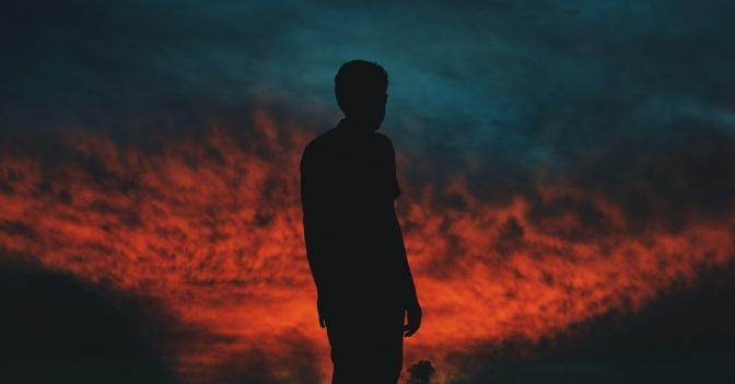 50916-man-standing-sunset-dark1200u.1200w.tn
