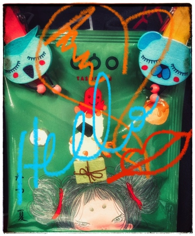 Drip coffee in package - green. With decorative wooden clothespins, and graffiti.